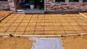 Pouring Concrete Patio Against a House