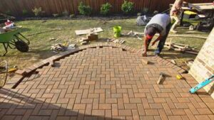 Masonry Workers Prevent Sinking Pavers